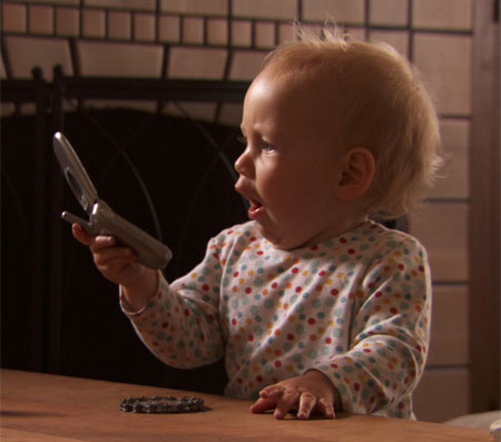 Baby amazed by cell phone