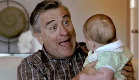 Robert DeNiro happy funny face with baby