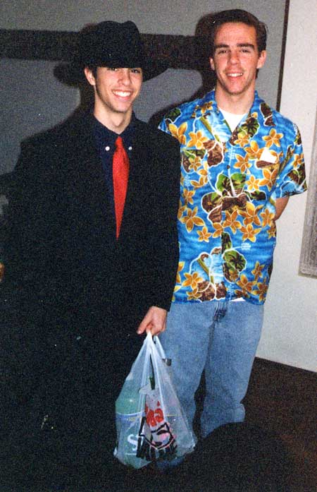 mark in suit and hat for new years 2000 with andrew snider