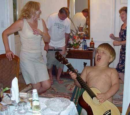 boy playing guitar man taking off pants party