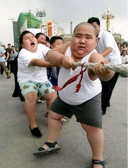 fat asian kids tug of war