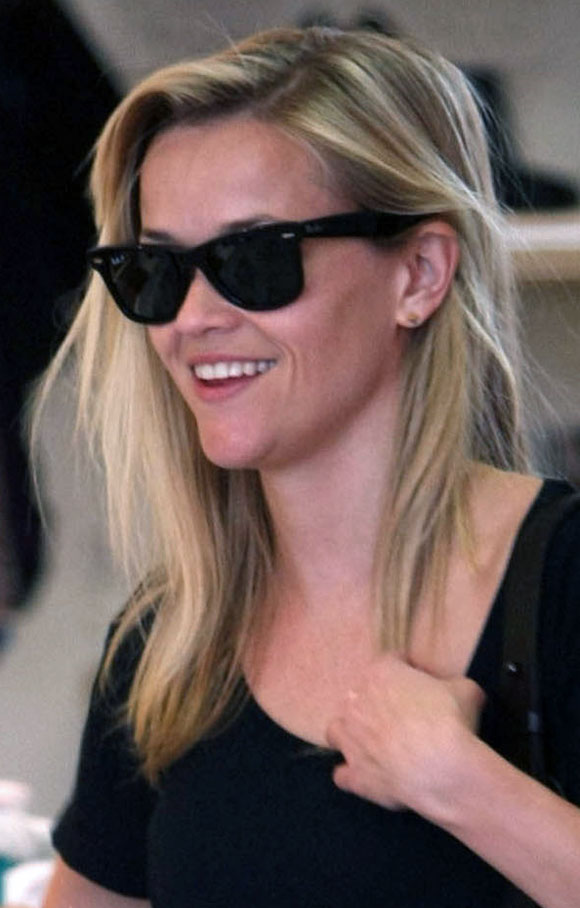 Reese Witherspoon with shades on in honor of her 35th birthday