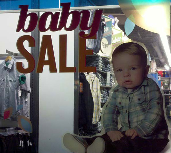Old Navy window ad baby sale