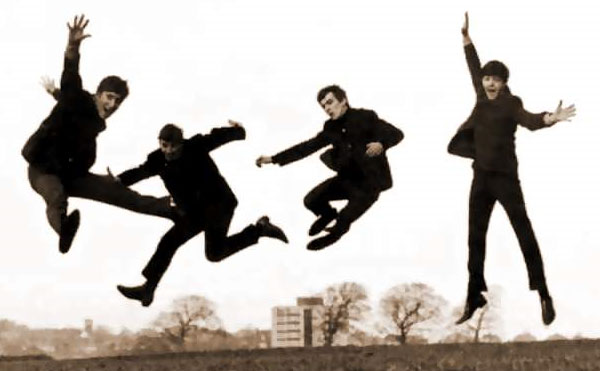 fab four beatles jumping