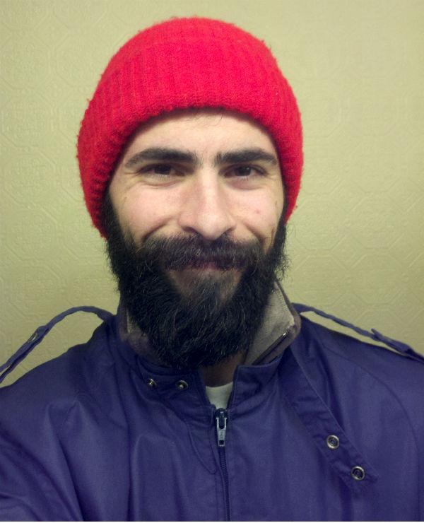 Mark Mushakian with beard and red beenie