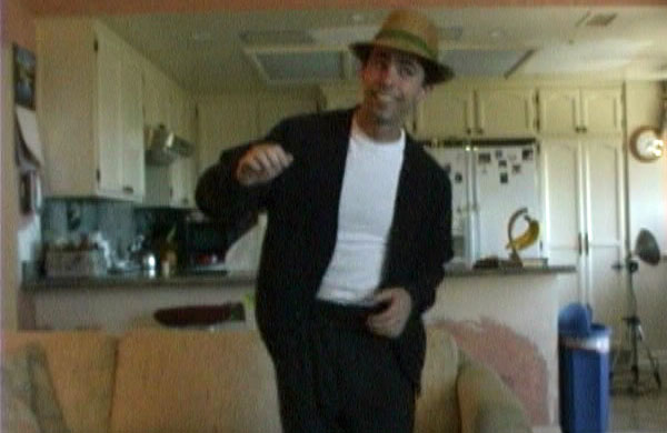 Mark Mushakian dancing with hat on in Dancing Mush video