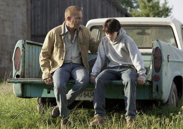 Kevin Costner as Jonathan Kent with young Clark