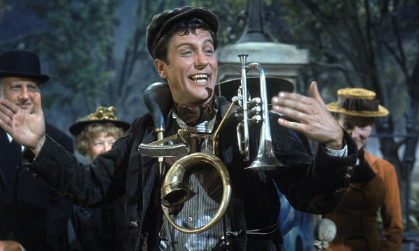 Bert one man band wearing instruments in Mary Poppins