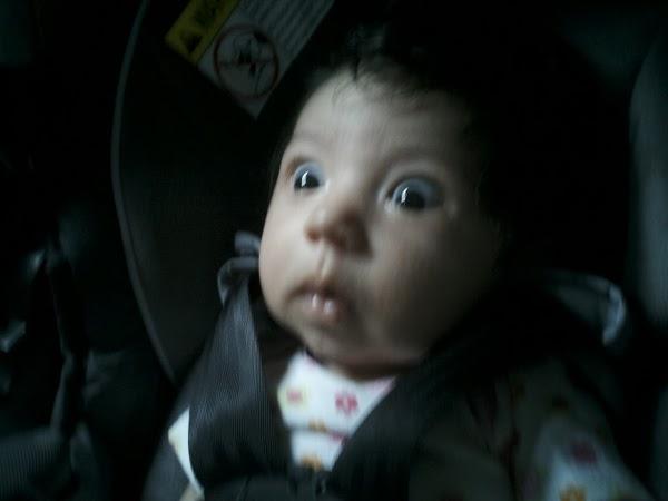 Horrified, wide-eyed baby