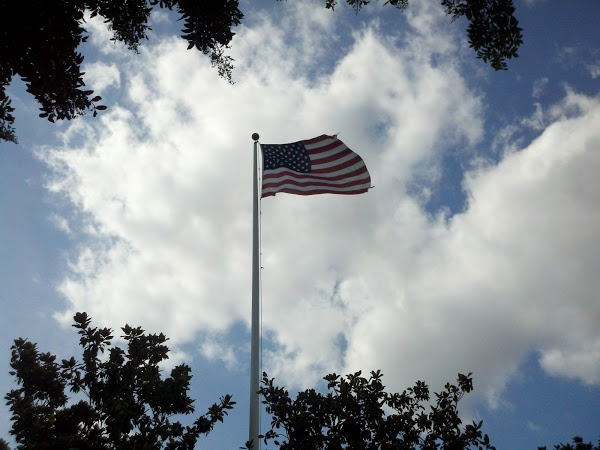Photograph 365 project picture a day American flag against cloudy sky