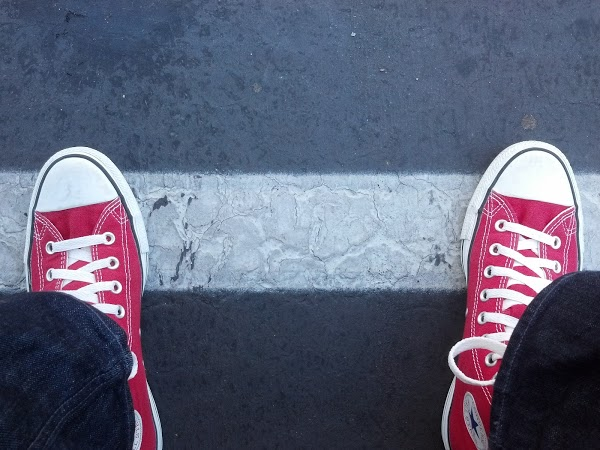Red Converse in parking lot