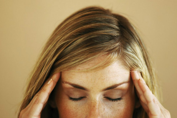 good looking woman head rub temple stress