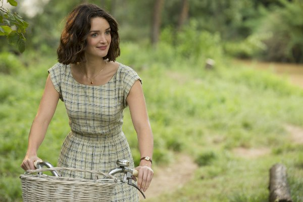 Charlotte le bon on bicycle in The Hundred-Foot Journey