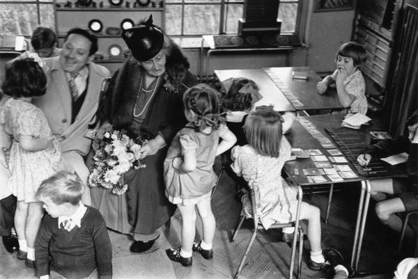 Maria Montessori with children in class