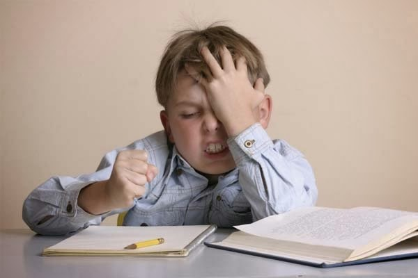 Frustrated kid with school homework