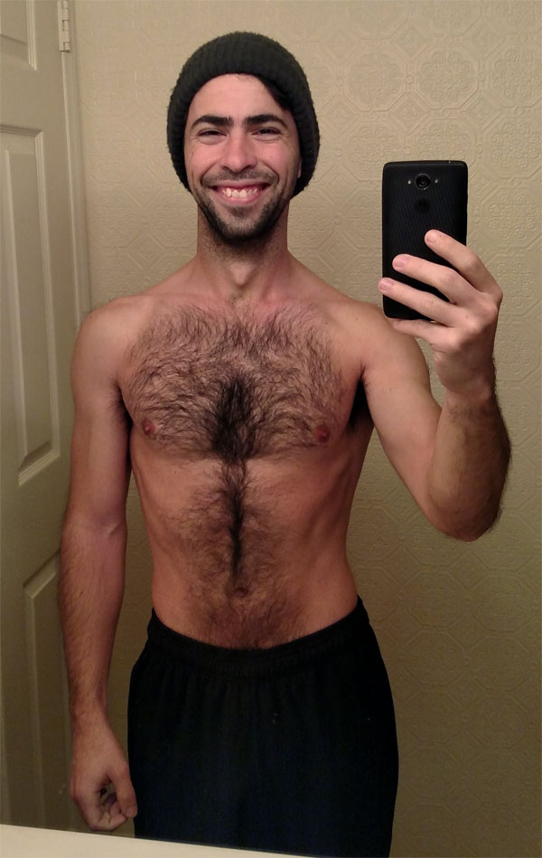 shirtless smiling and hairy Mark Mushakian with a beanie