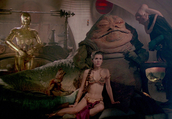 Jabba the Hutt in Return of the Jedi with slave Princess Leia