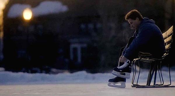 Gordon Bombay lacing up ice skates from Mighty Ducks