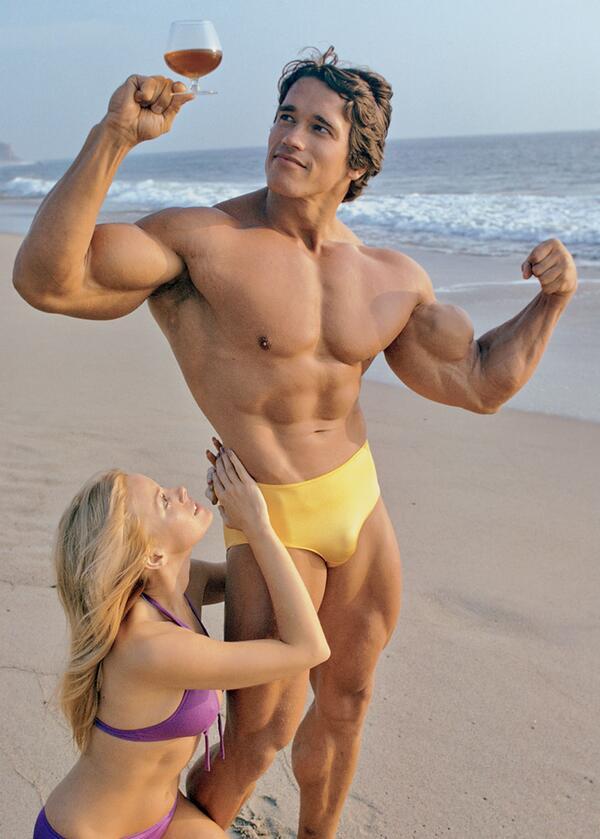 Arnold bodybuilder wine glass beach